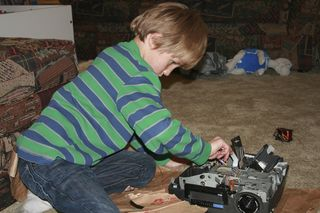 Max taking apart a slide projector